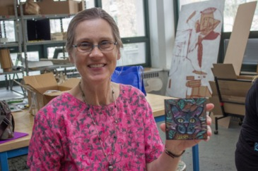 Cathryn Paulsen and her embossed book cover.