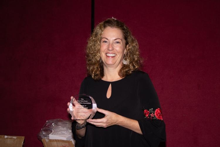 Lisa gets the Region 7 teacher of the year award.